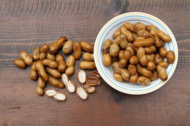 Bowl of boiled peanuts stock photo