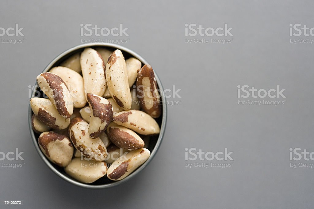 Bowl of brazil nuts stock photo