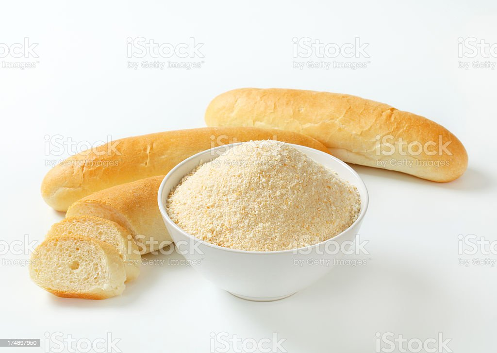 bowl of breadcrumbs and rolls stock photo