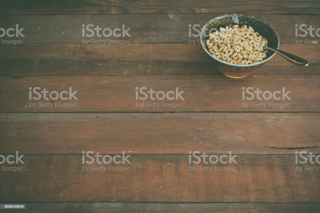 Bowl of breakfast cereal on rustic old table