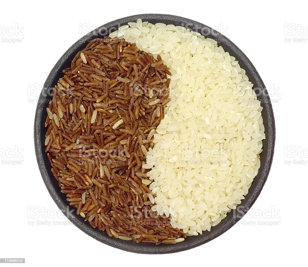 Bowl of brown and white rice royalty-free stock photo