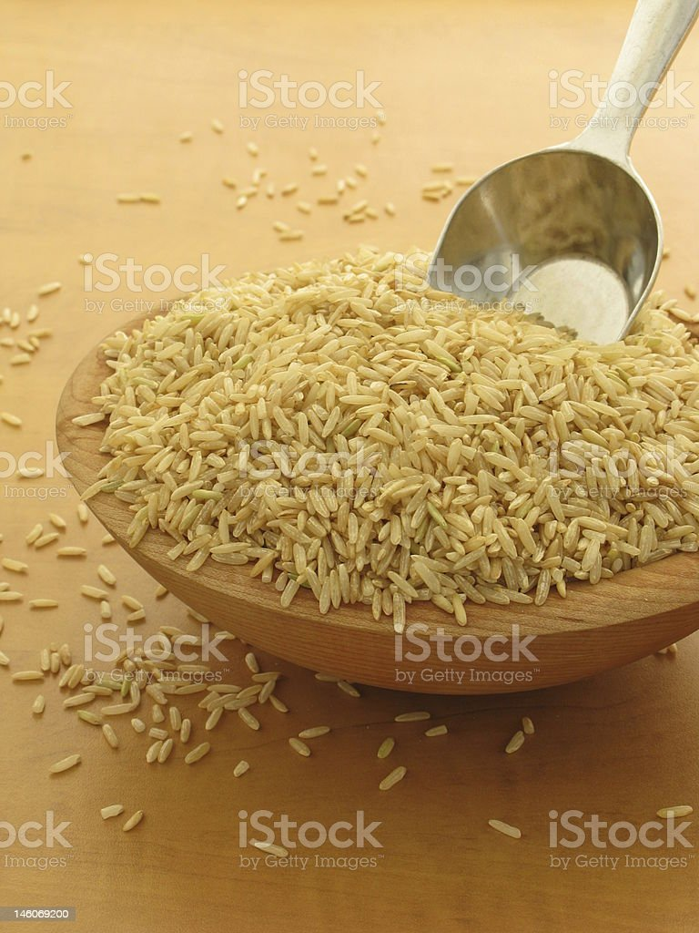 Bowl of Brown Rice Grains stock photo