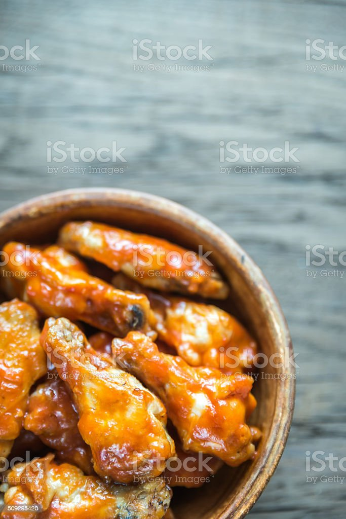 Bowl of buffalo chicken wings stock photo