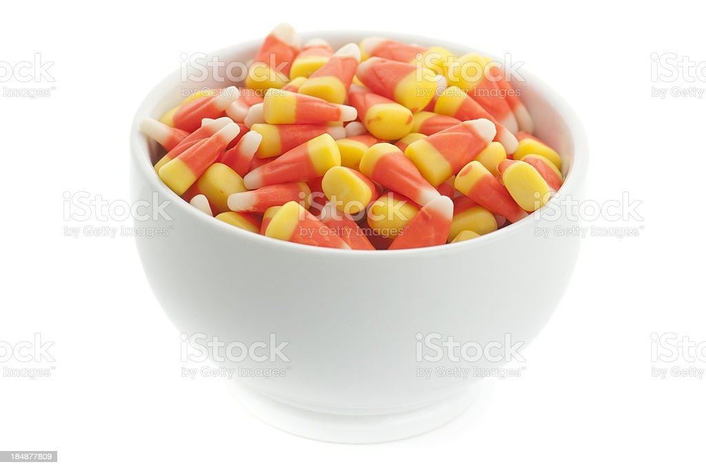 Bowl of candycorn candy on white background royalty-free stock photo