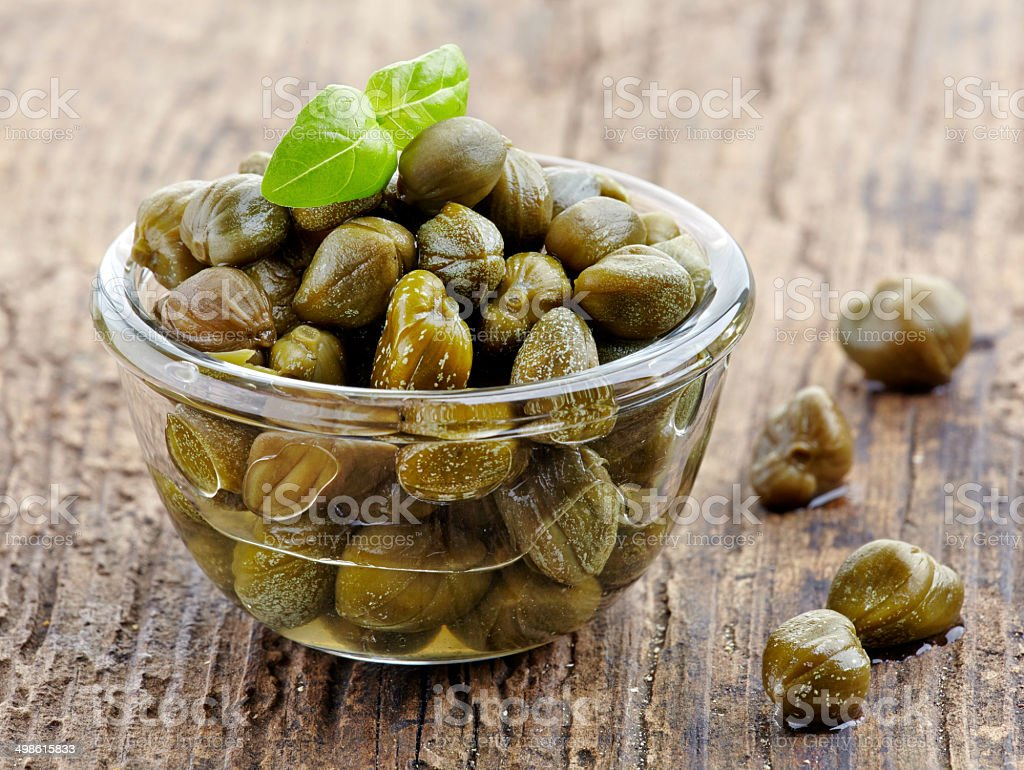 bowl of capers stock photo