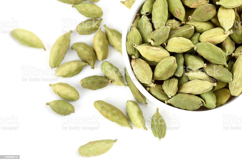 bowl of Cardamoms on white background stock photo