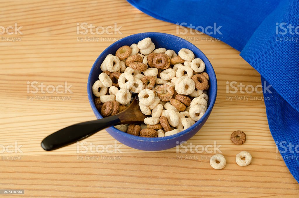 Bowl of cereal and a blue napkin stock photo