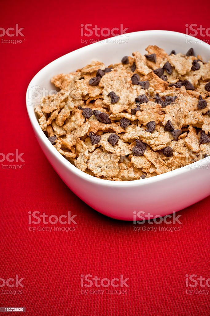Bowl of Cereal with Chocolate Chips on Red Background stock photo