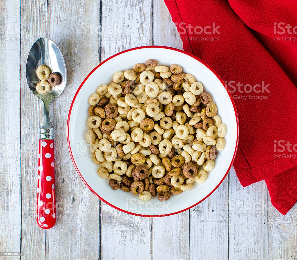 Bowl of cereal with spoon stock photo