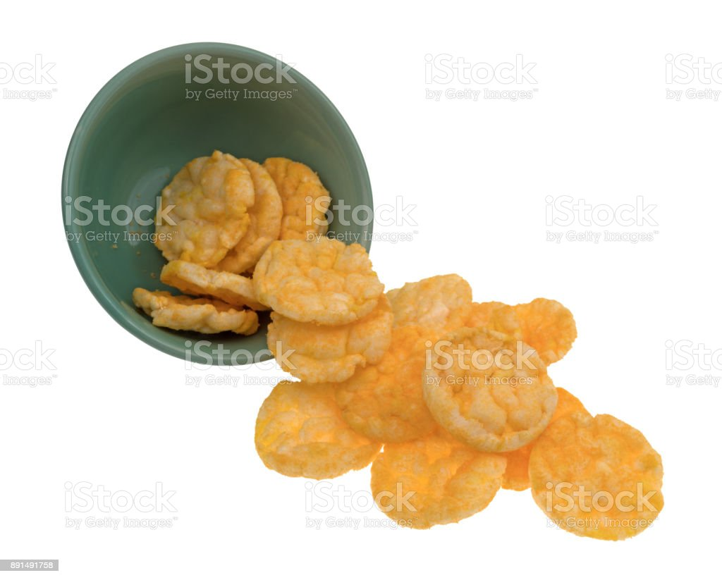 Bowl of cheddar cheese rice cakes spilling stock photo