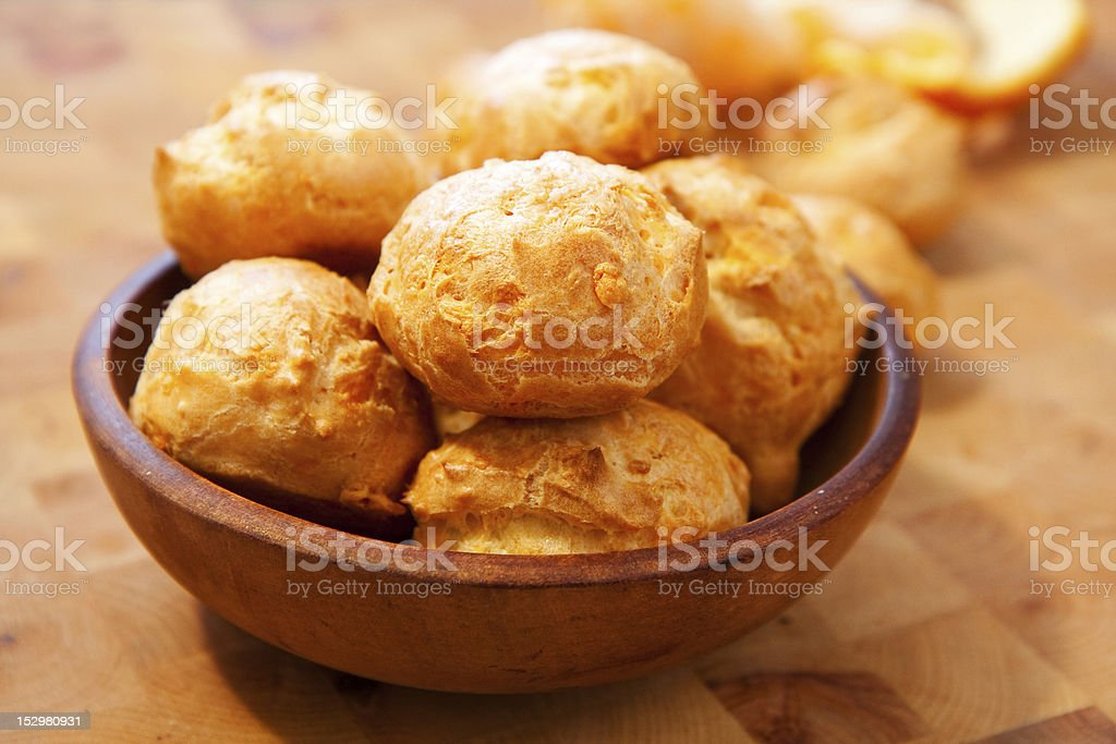 Bowl of cheese gougeres on table stock photo