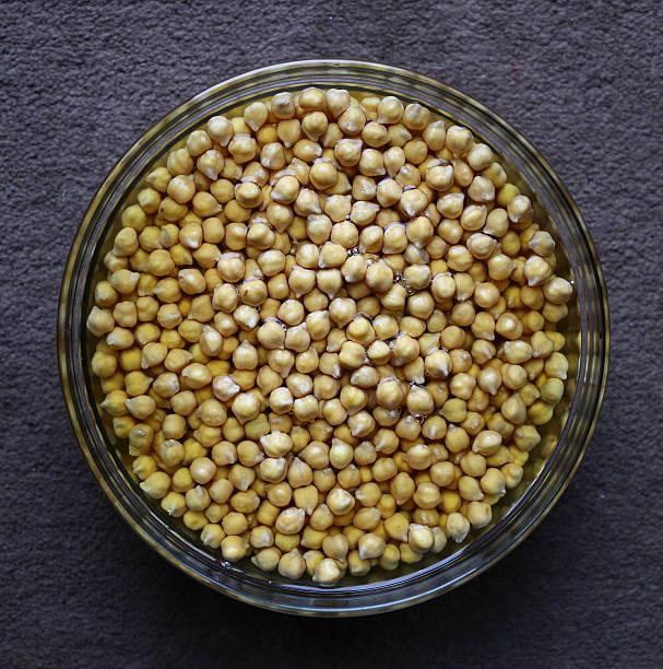 Bowl of chick peas soaking stock photo