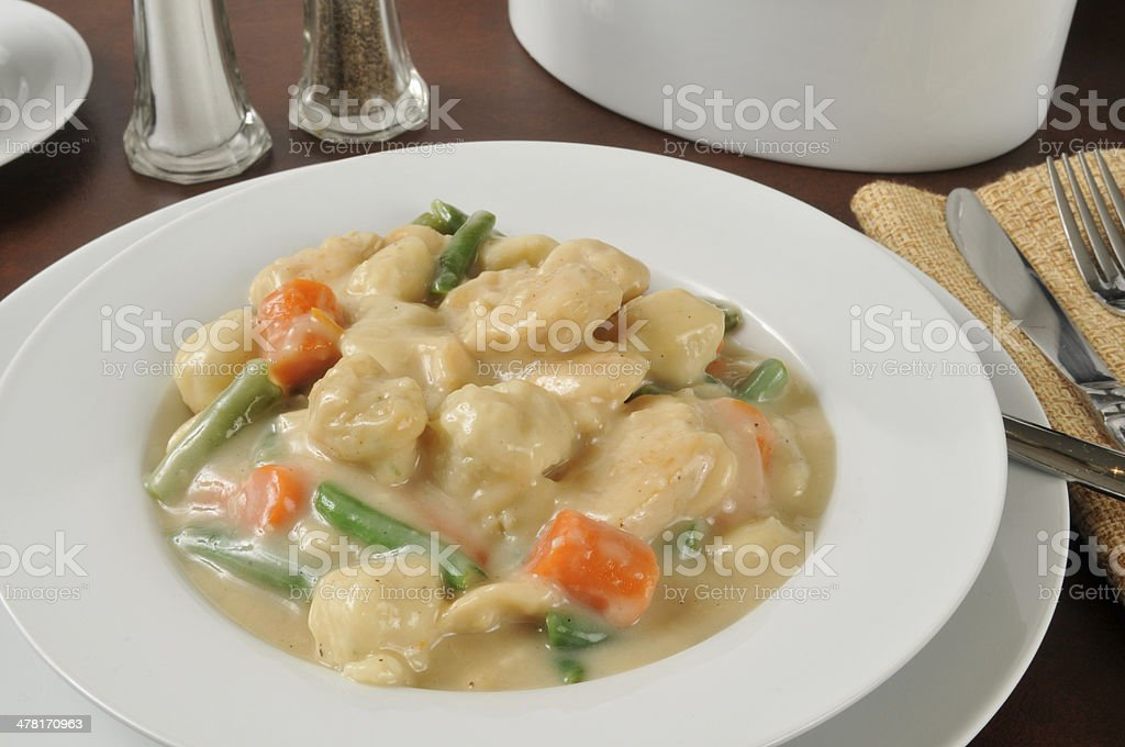 Bowl of chicken and dumplings stock photo