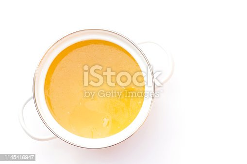 Bowl of chicken broth isolated on white background.