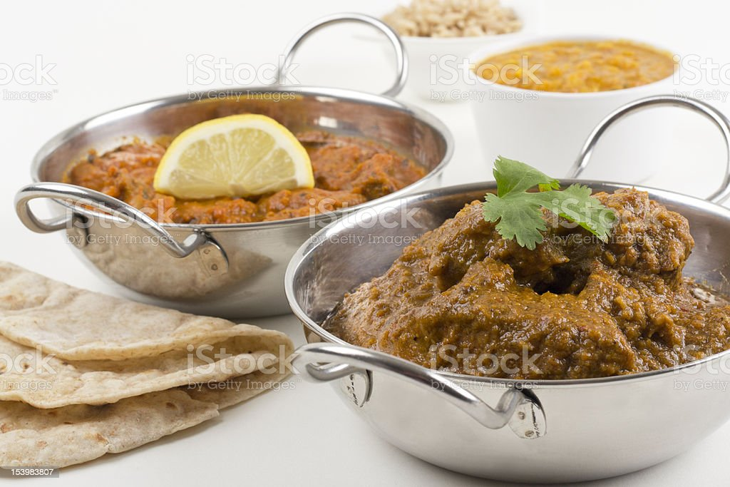 A bowl of chicken xacuti and meat madras royalty-free stock photo