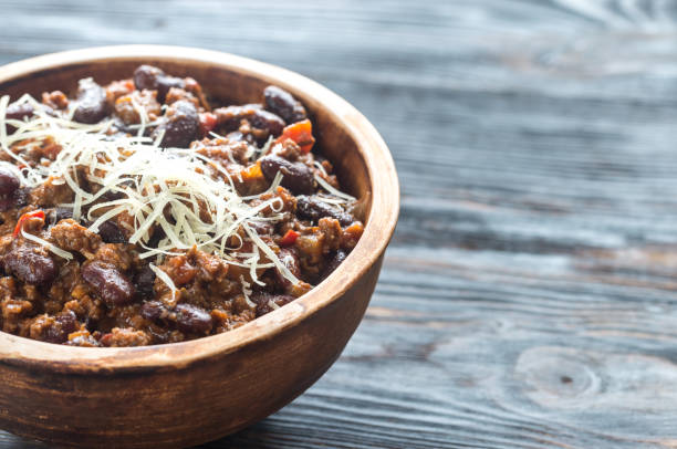 bowl of chili con carne - chilli stock photos and pictures