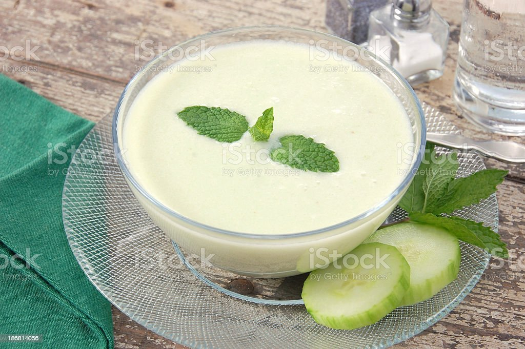 Bowl of chilled creamy cucumber soup royalty-free stock photo