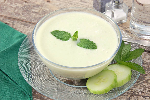 Bowl of chilled creamy cucumber soup stock photo