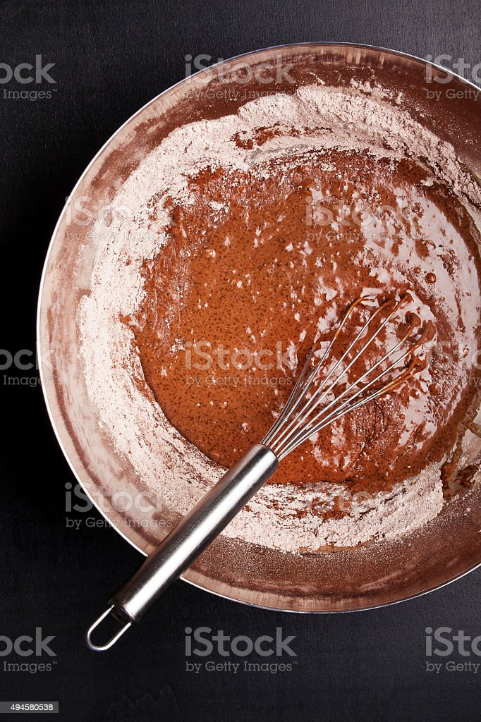 bowl of Chocolate Dough and Whisk stock photo