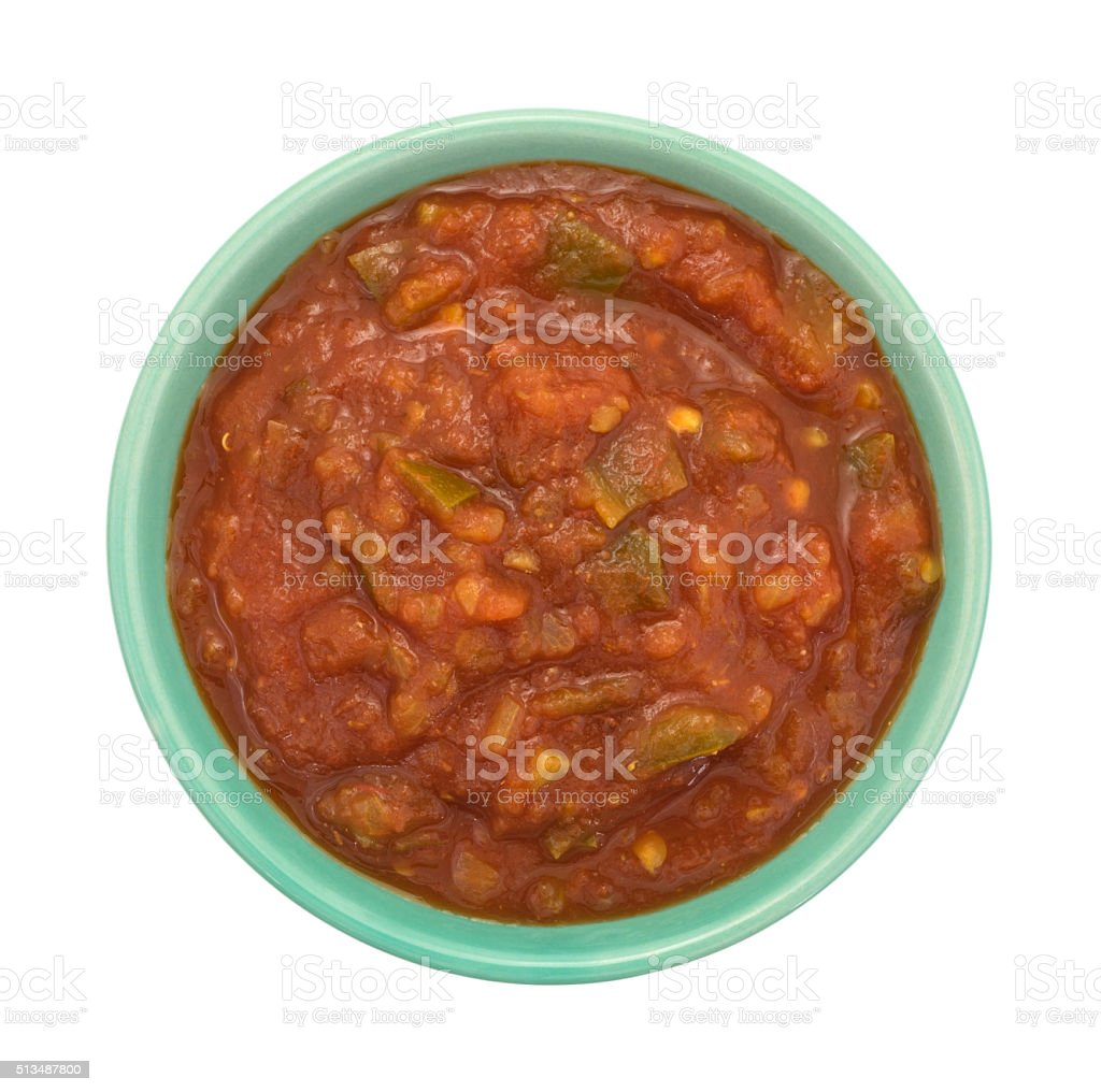 Bowl of chunky salsa sauce on a white background stock photo