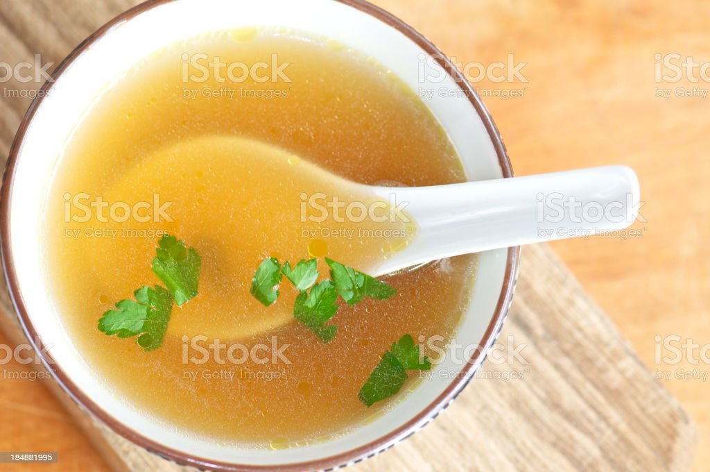 Bowl of Clear Broth from Above royalty-free stock photo
