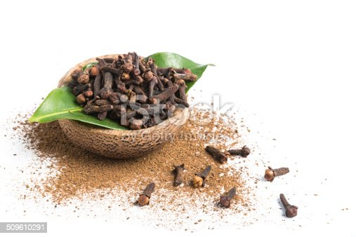 istock Bowl of clove isolated on white 509610291