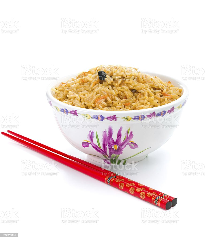 Bowl of cooked rice with chopsticks royalty-free stock photo