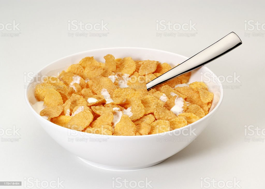 Bowl of corn flakes with spoon stock photo