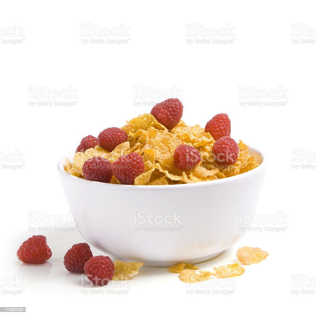 Bowl of cornflakes and raspberries stock photo