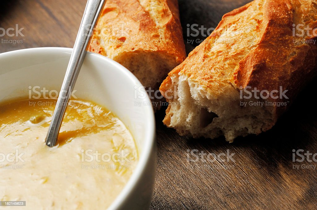 bowl of country vegetable soup with French stick bread stock photo