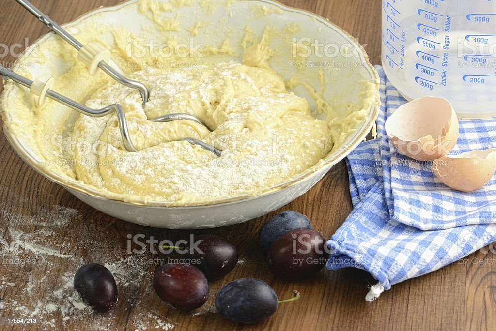 bowl of crumpet cake with plums stock photo