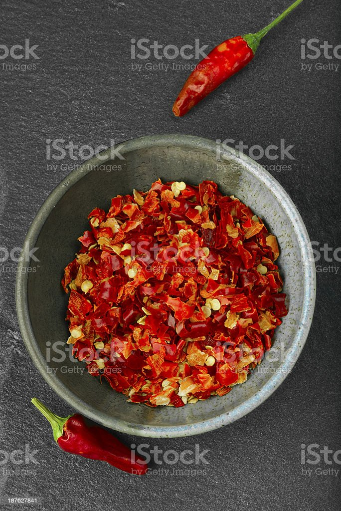Bowl of crushed spicy pepper. stock photo