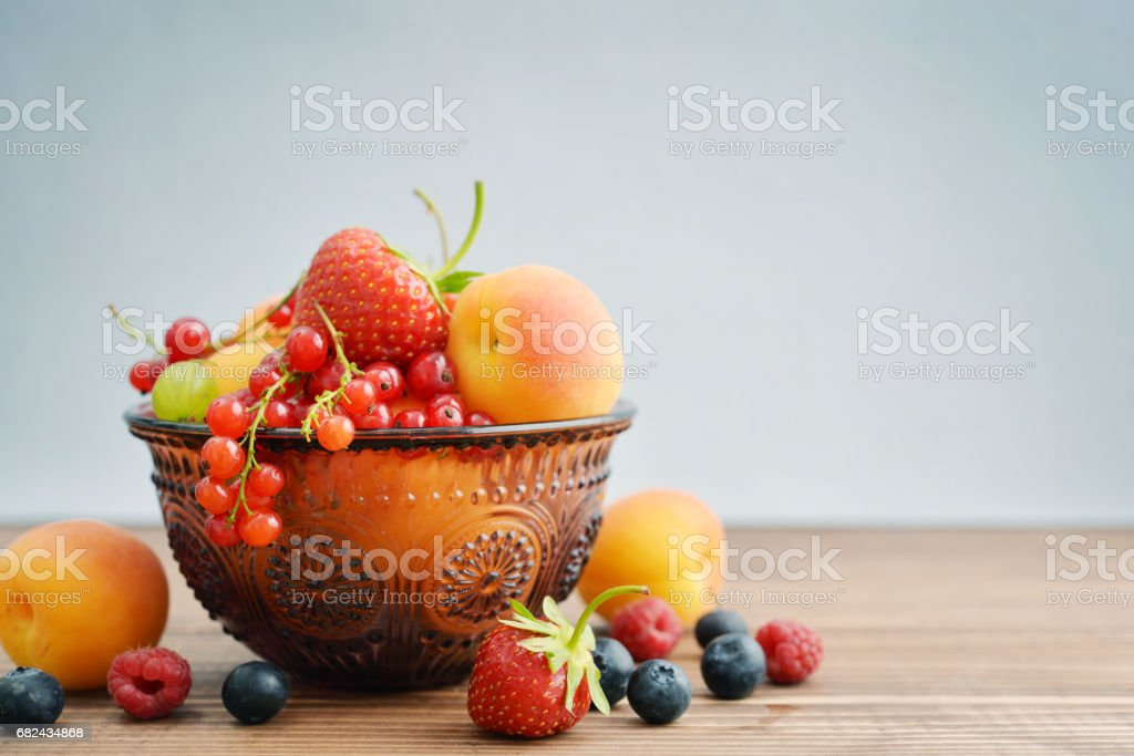 Bowl of different fresh berries royalty-free stock photo