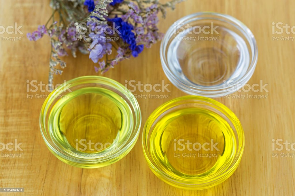 Bowl of different organic oil - cold pressed Coconut oil, Jojoba Oil, Caster oil stock photo