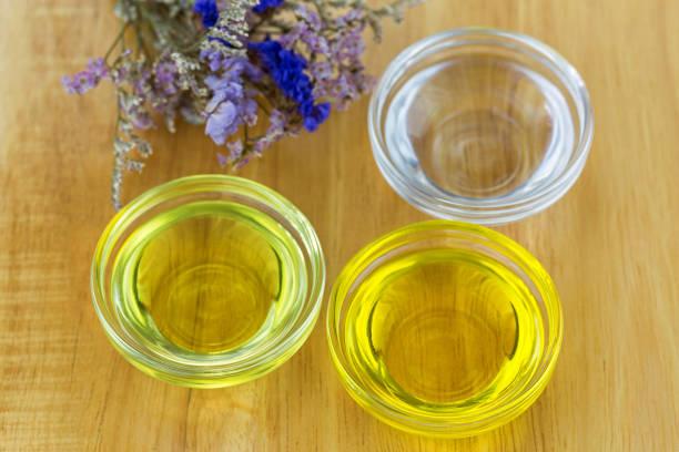 Bowl of different organic oil - cold pressed Coconut oil, Jojoba Oil, Caster oil stock photo