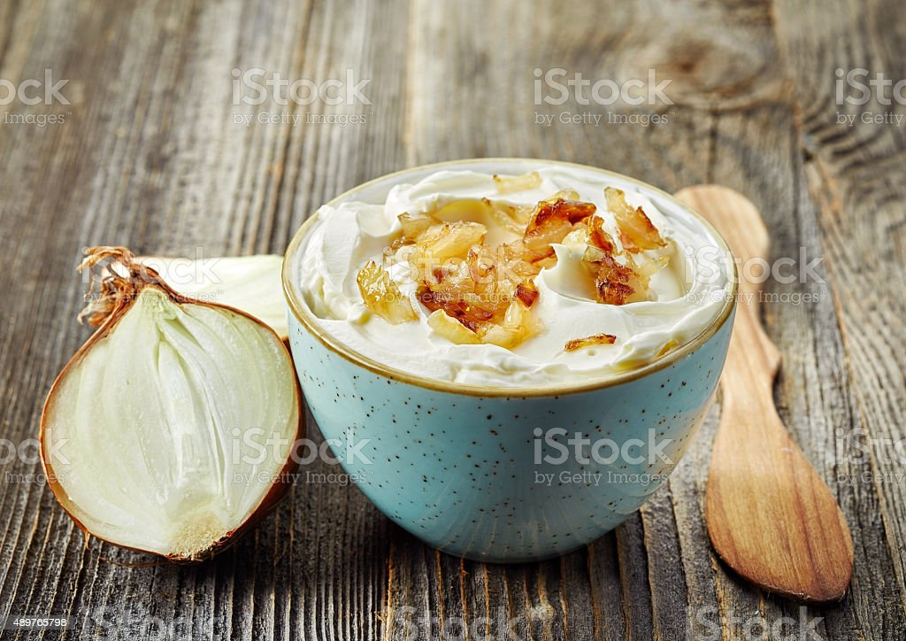 bowl of dip sauce with caramelized onions stock photo