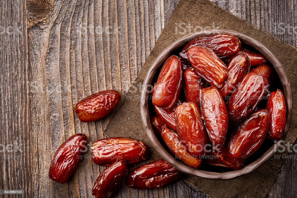Bowl of dried dates stock photo
