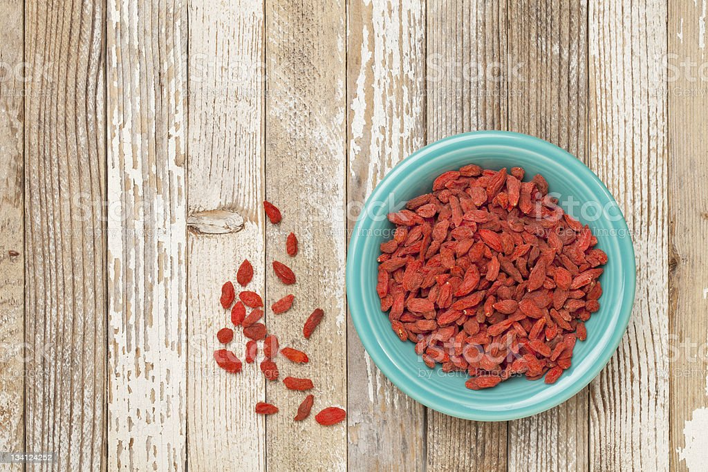 bowl of dried wolfberries stock photo