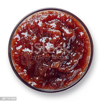 Bowl of fig jam isolated on white background from top view