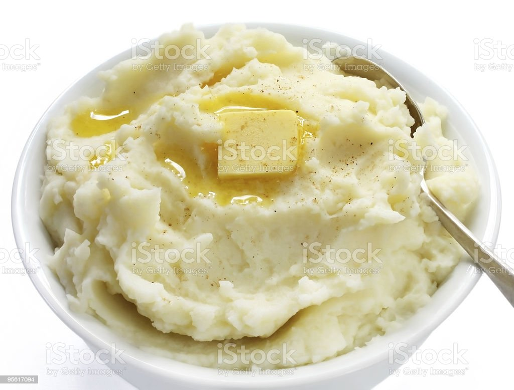 A bowl of finely mashed potato with butter on top stock photo