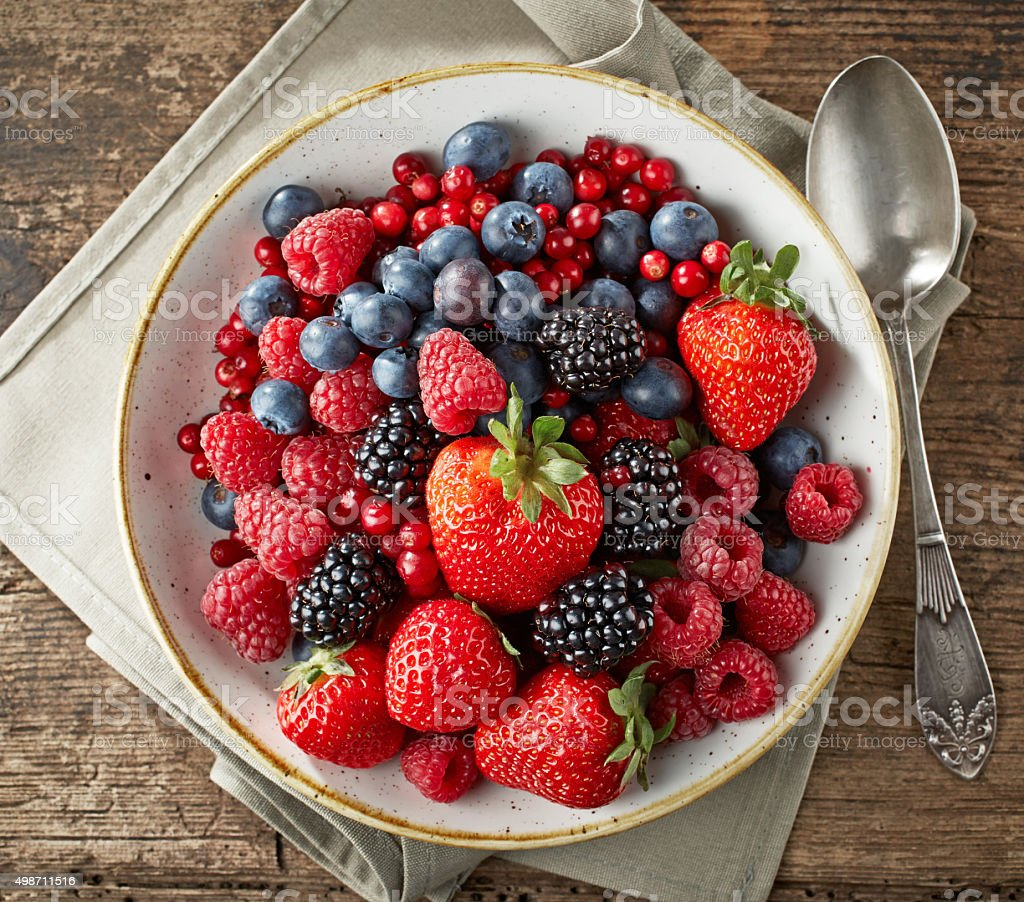 bowl of fresh berries stock photo