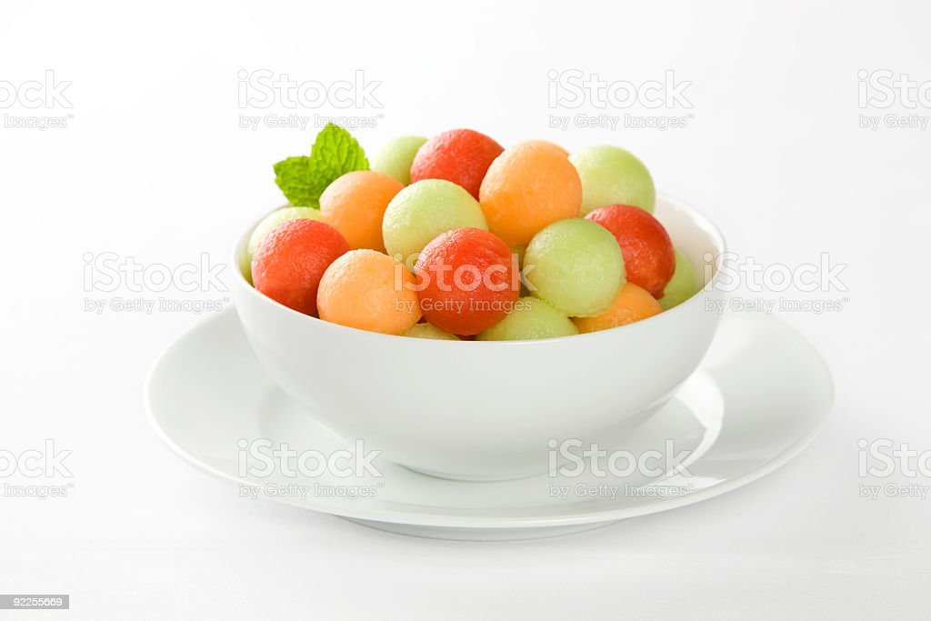Bowl of fresh fruit with  watermelon, honeydew and canteloupe stock photo