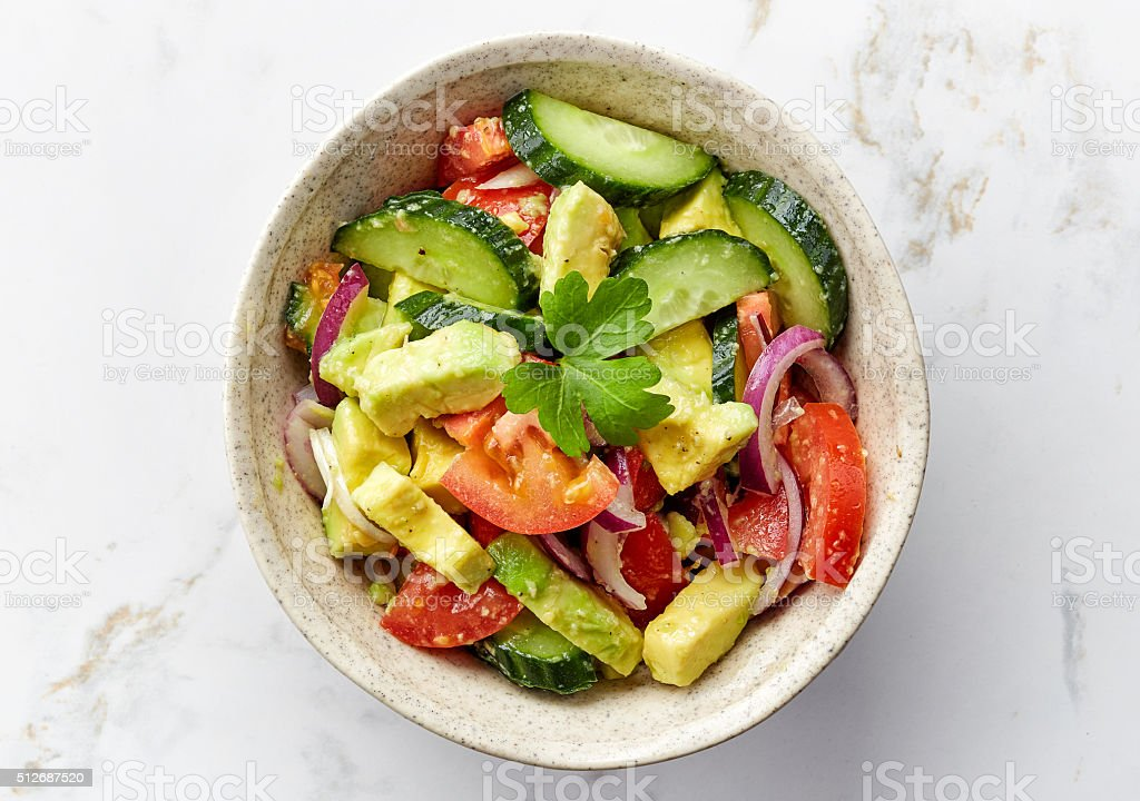 bowl of fresh vegetable salad stock photo