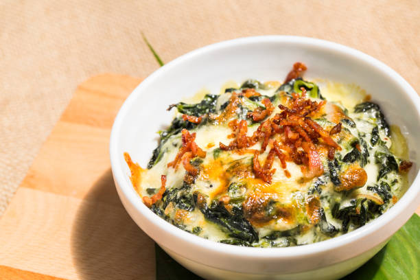 Bowl of fresh vegetarian spinach with cheese and fried minced sweet pork. stock photo