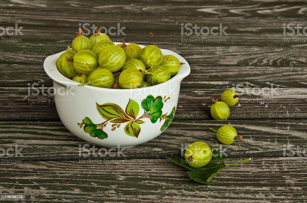 Bowl of freshly picked gooseberries stock photo