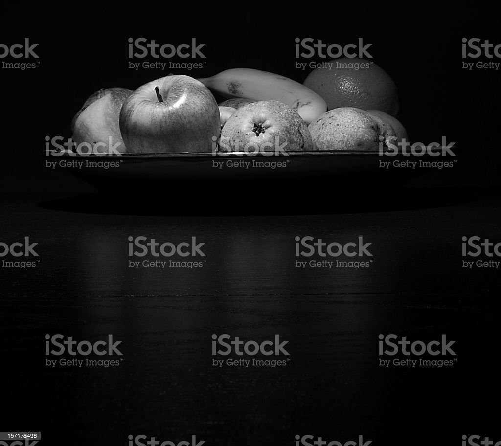 Bowl of fruits A bowl of fruits, black and white, reflection Apple - Fruit Stock Photo