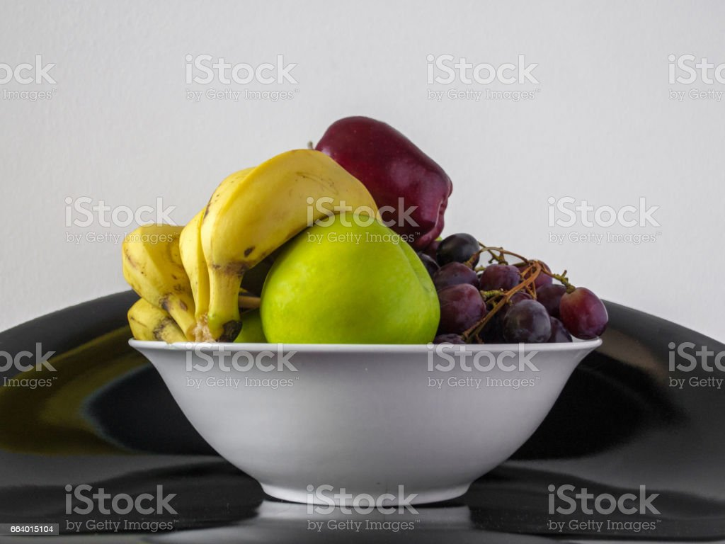 A bowl of fruits stock photo