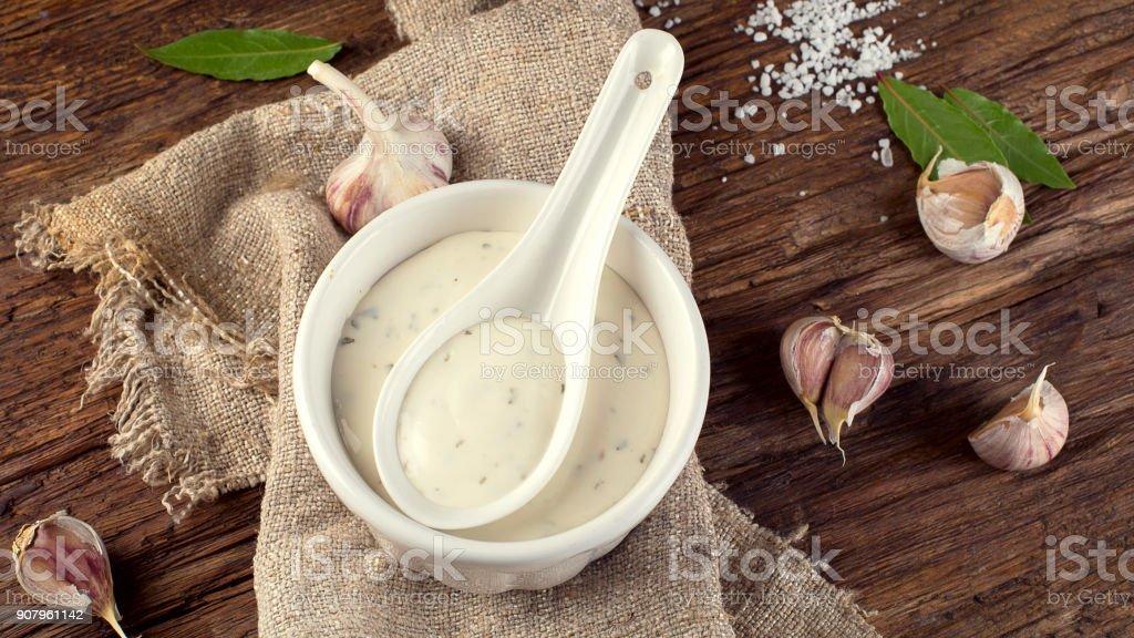 Bowl of Garlic sauce or mayonnaise stock photo