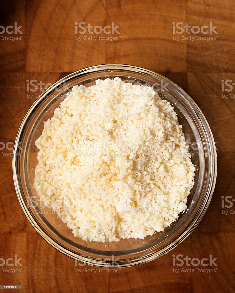 Bowl of grated parmesan cheese royalty-free stock photo