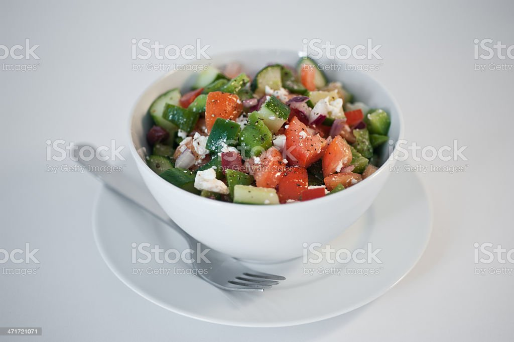 Bowl of greek salad stock photo